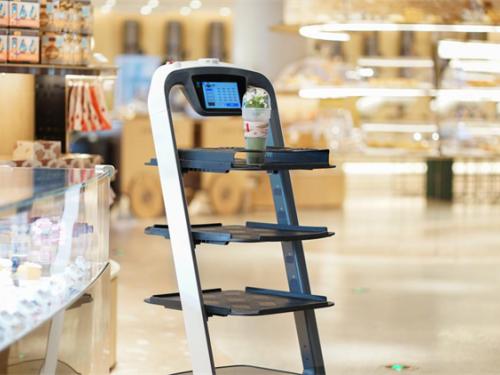 普渡送餐机器人上岗深圳最大的烘焙坊ANGSI昂司